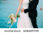 the groom embraces the bride on ... | Shutterstock . vector #608689598