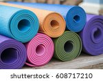 colorful yoga mats on the table | Shutterstock . vector #608717210