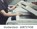 woman hands putting a sheet of...   Shutterstock . vector #608717438