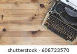old typewriter on wooden desk | Shutterstock . vector #608723570