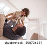 cheerful young boy having fun... | Shutterstock . vector #608736134