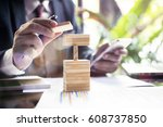 Small photo of Planning, risk and strategy in business, business gambling placing wooden block