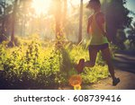 young fitness woman running at... | Shutterstock . vector #608739416