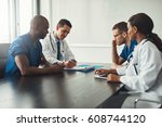 multiracial medical team having ... | Shutterstock . vector #608744120
