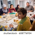 arabian muslim family eating... | Shutterstock . vector #608776934
