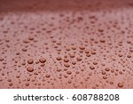 Raindrops On The Hood Of A Car