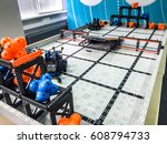 Small photo of Robotics Competition. Different robots collection presented on white table in Moscow VEX Robotics Competition Mechanical robots. Modern robotic equipment examples.Robotics Competition fight background