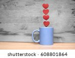 cup of coffee with hearts on a... | Shutterstock . vector #608801864