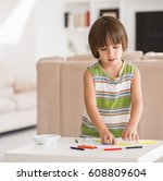 cute boy drawing at home | Shutterstock . vector #608809604