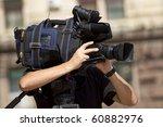 cameraman working in the street | Shutterstock . vector #60882976