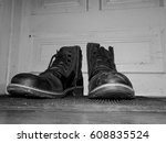 dirty boots on old wooden door...