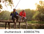 two fishermen with fishing rods ... | Shutterstock . vector #608836796