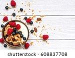 bowl of oat granola with yogurt ... | Shutterstock . vector #608837708