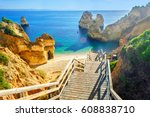 Wooden footbridge to beautiful beach Praia do Camilo near Lagos in algarve region, Portugal