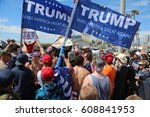 Small photo of Huntington Beach, CA - March 25 2017: Make America Great Again March. Supporters and protesters of republican president Donald Trump, cheer and jeer at a MAGA March in Huntington Beach.
