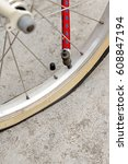 Small photo of Flat tires of bicycle with air pump valve.