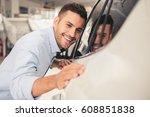 visiting car dealership.... | Shutterstock . vector #608851838