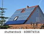 solar collector on tiled roof | Shutterstock . vector #608876516
