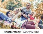 friends having fun outdoors... | Shutterstock . vector #608942780