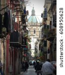 Small photo of Old street of the center of Palermo Sicily. After all the church of San Francesco Saverio. Italy. June 2015.