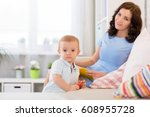 mother with child playing in... | Shutterstock . vector #608955728