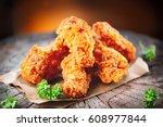 fried chicken wings on wooden...   Shutterstock . vector #608977844