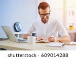 handsome man working from home... | Shutterstock . vector #609014288