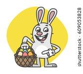easter bunny points on basket... | Shutterstock .eps vector #609053828