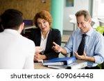 happy business partners... | Shutterstock . vector #609064448
