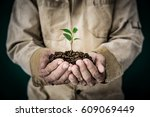 senior man holding young plant... | Shutterstock . vector #609069449