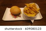 burger with chips on table | Shutterstock . vector #609080123