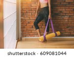 unrecognizable woman in a yoga... | Shutterstock . vector #609081044