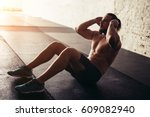 muscular man exercising doing... | Shutterstock . vector #609082940