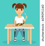 little girl eats sitting at the ... | Shutterstock .eps vector #609091160
