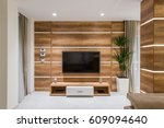tv set on wooden waal in living ... | Shutterstock . vector #609094640