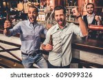 handsome friends are drinking... | Shutterstock . vector #609099326