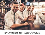 handsome businessmen are... | Shutterstock . vector #609099338