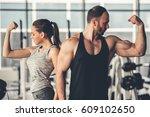 beautiful sports couple is... | Shutterstock . vector #609102650