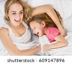 mom and daughter laughing | Shutterstock . vector #609147896