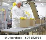 manual worker in white uniform... | Shutterstock . vector #609152996