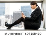 woman sitting and using tablet... | Shutterstock . vector #609168410