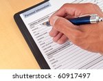 Filling Out Personal Information Worksheet - stock photo