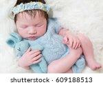serene baby girl all dressed in ... | Shutterstock . vector #609188513