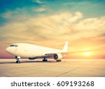 Commercial Airplane With Sunrise