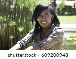 an african woman sits at the...   Shutterstock . vector #609200948