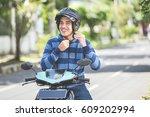 happy man fastening his... | Shutterstock . vector #609202994