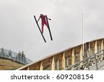 Small photo of Ski jump. Artificial track. Sport background. Norwegian summer. Horizontal