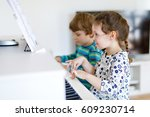 two little kids girl and boy... | Shutterstock . vector #609230714