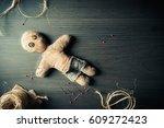 voodoo doll on a wooden... | Shutterstock . vector #609272423
