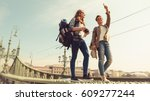 two young girlfriends traveling ... | Shutterstock . vector #609277244